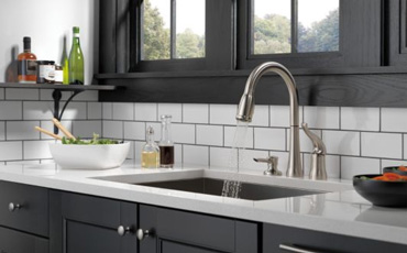 delta 16970 sssd dst kate pull down review stainless rh faucetguide net delta kate single handle pulldown kitchen faucet delta kate single-handle kitchen pull-down faucet